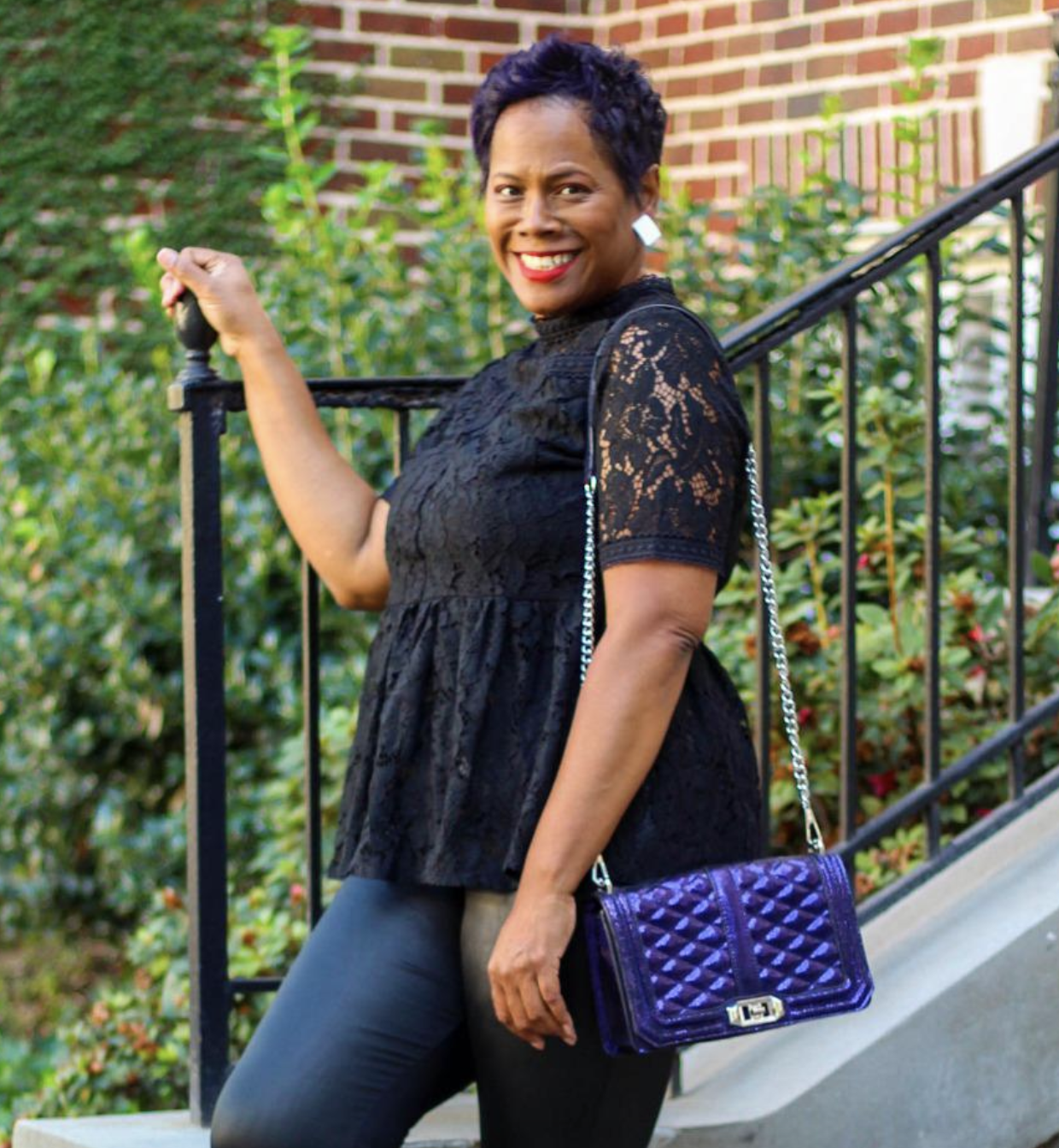 reviewer wearing black lace high-neck top