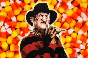 Freddy Kruger in front of a background of candy corn