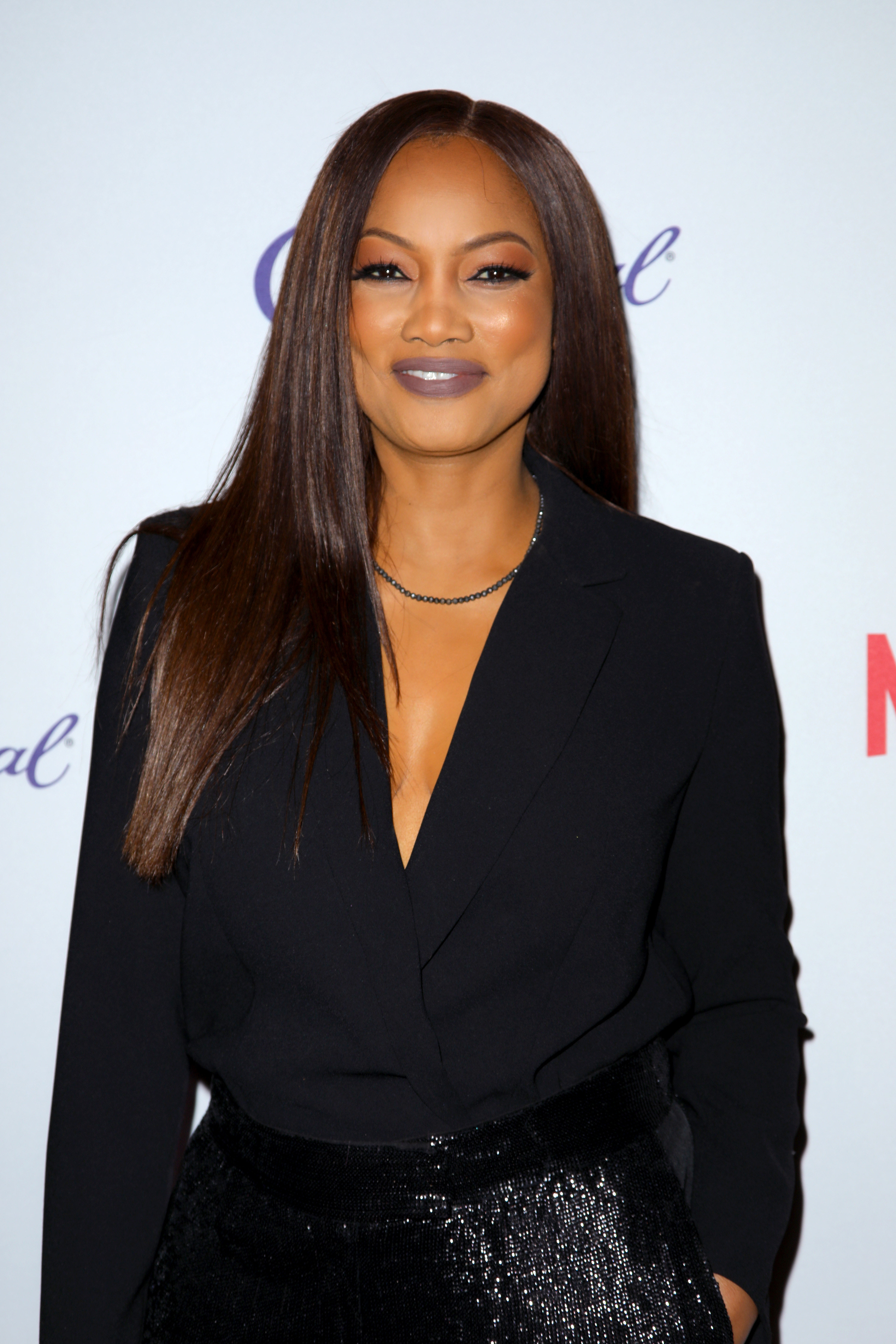 Garcelle wearing a dark outfit posing at an event
