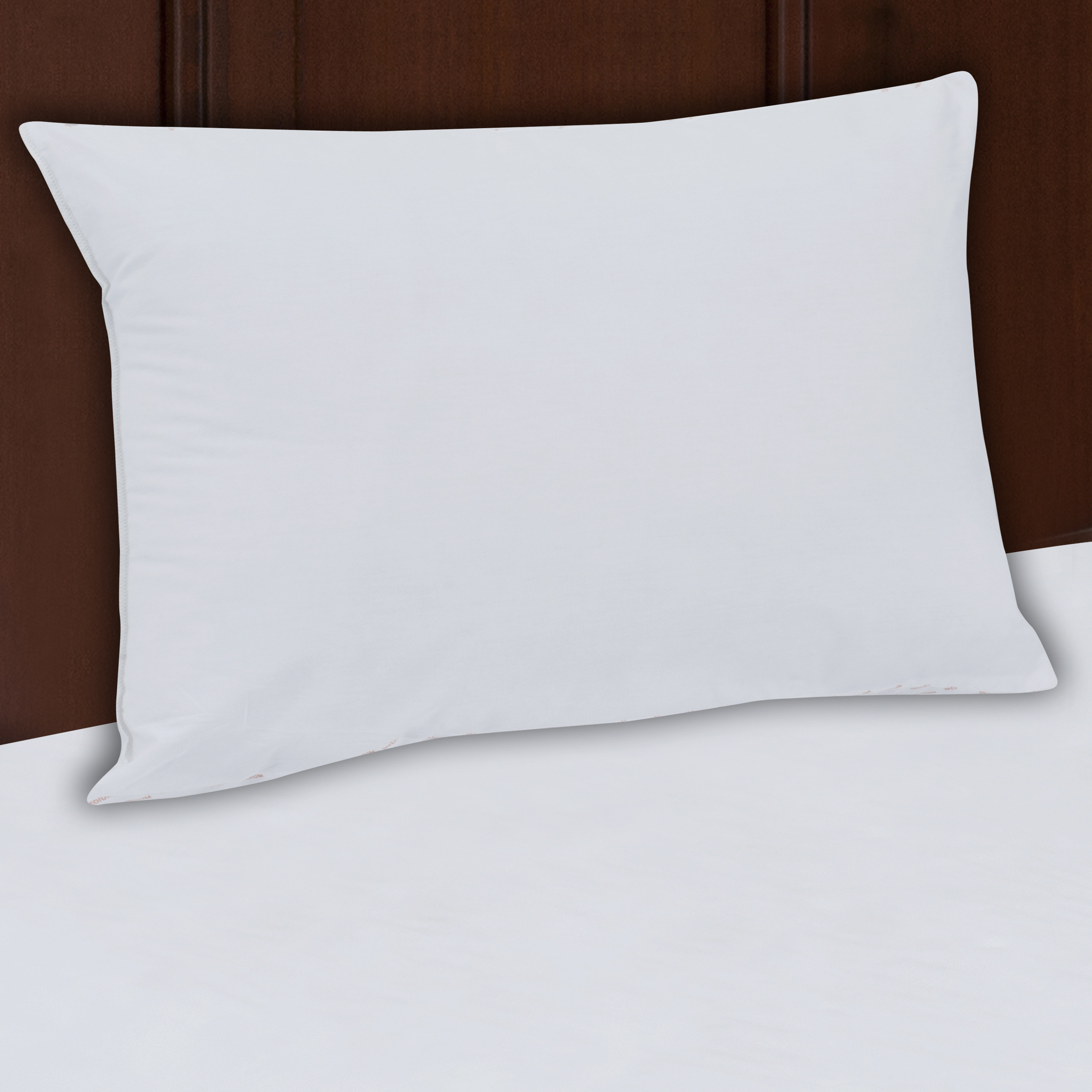 The white pillow on bed
