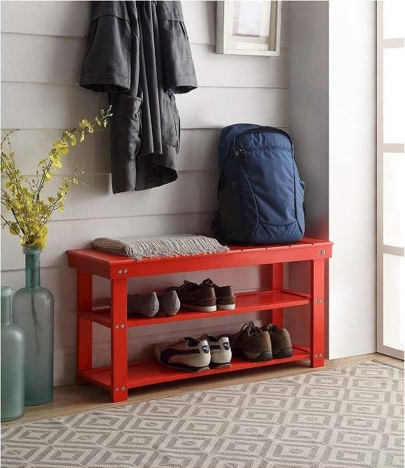 The red Oxford Utility Mudroom Bench storing shoes in an entryway