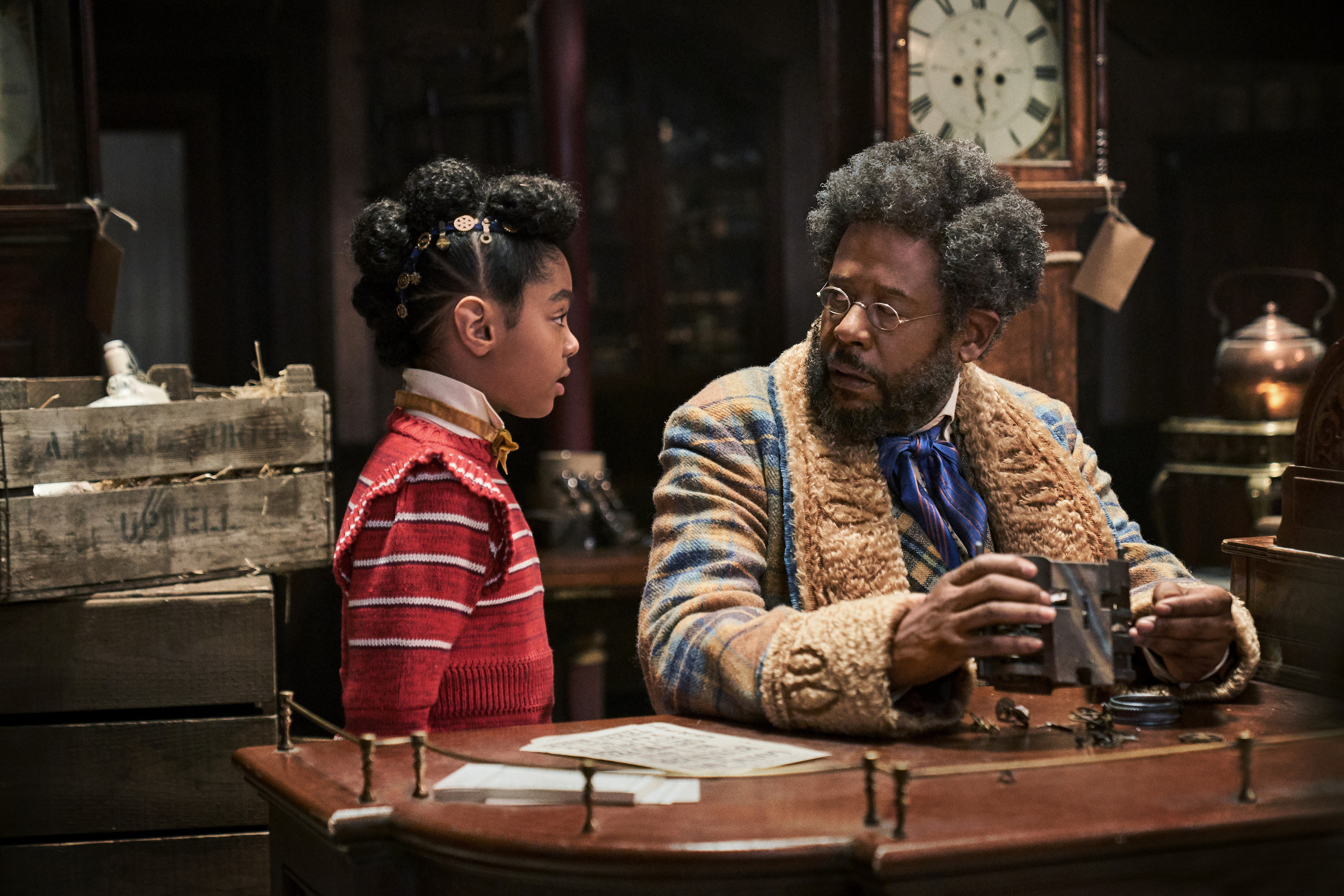 Forest Whitaker dressed in costume talking to a young girl