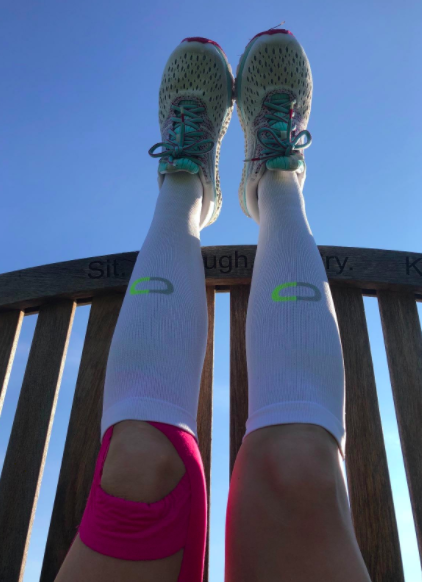 Reviewer wears white compression socks with light blue running sneakers