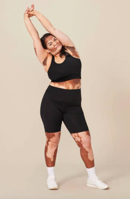 model wears the leggings that hit mid thigh