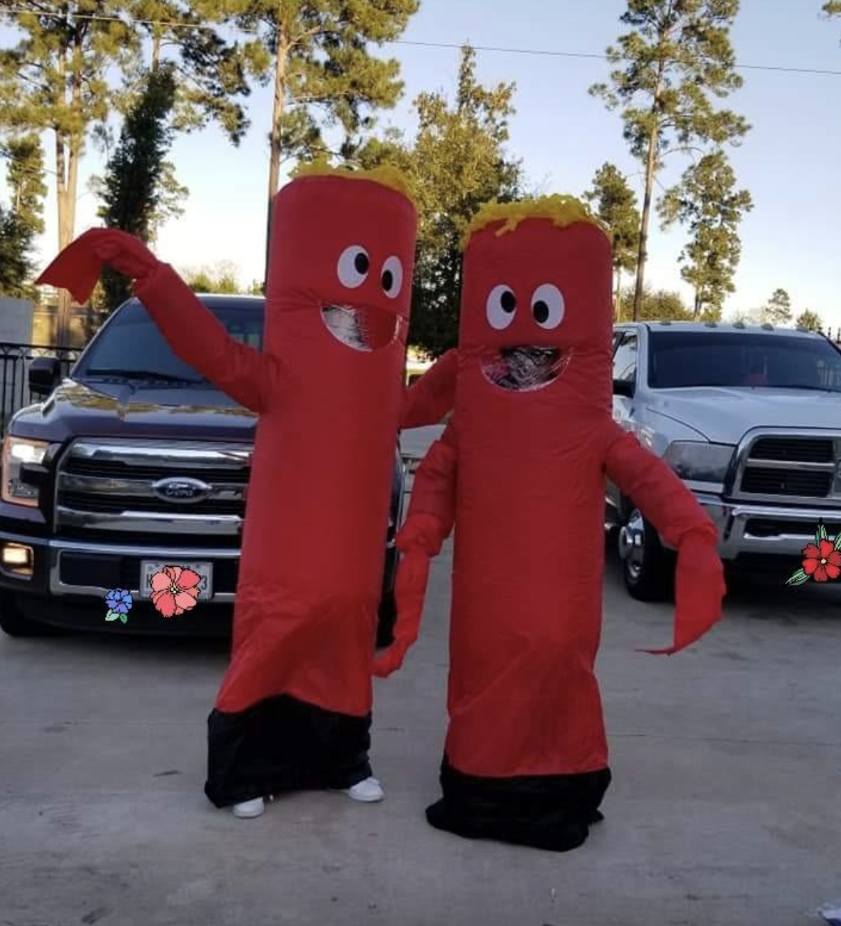 reviewers wearing the red waving arm costume