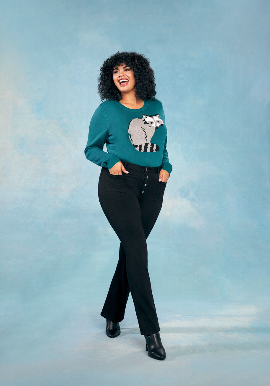 teal sweater with raccoon on it