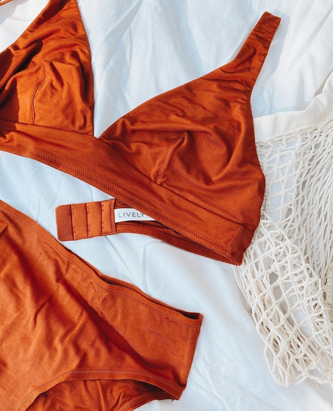 burnt orange bralette and underwear