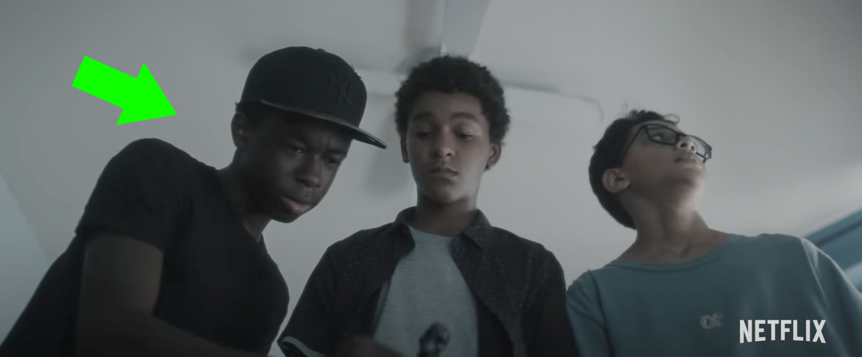 Bobby, Luis, and Miguel looking at something