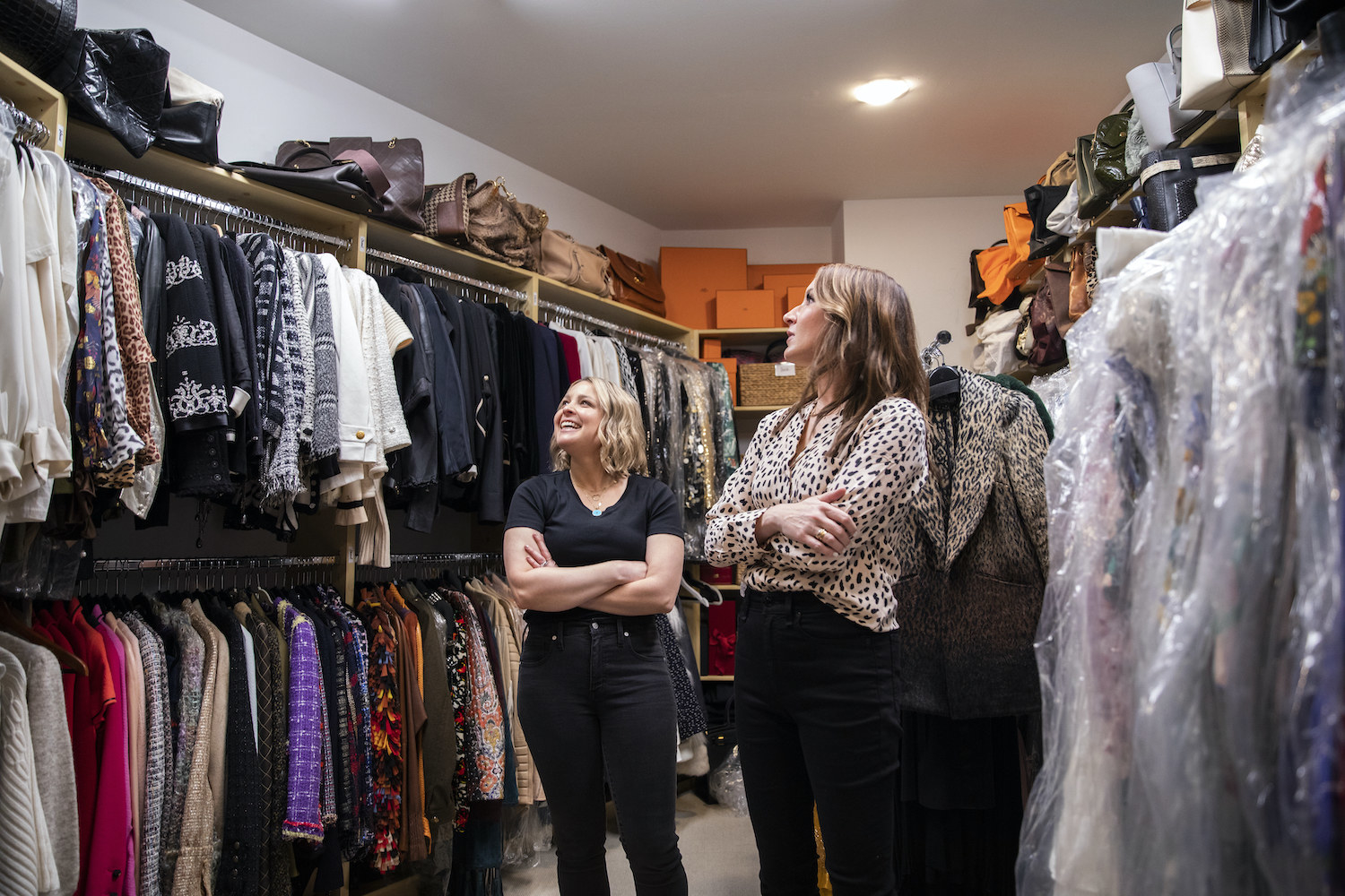 Joanna Teplin and Clea Shearer looking at a busy closet