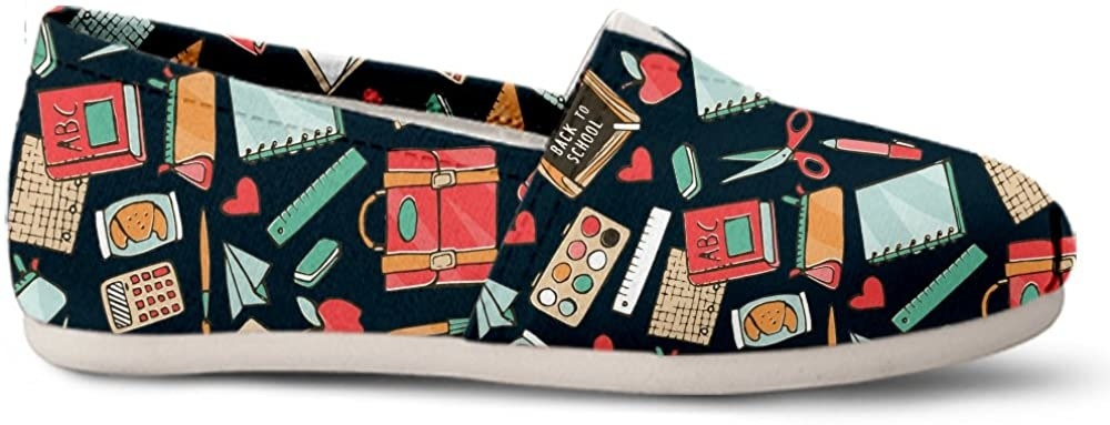 """The black shoes printed with supplies like notebooks, rulers, pens, calculators, pencil cases, scissors, books, and messenger bags plus lunch bags, hearts, apples, paper airplanes, and a chalkboard reading """"Back to school"""""""