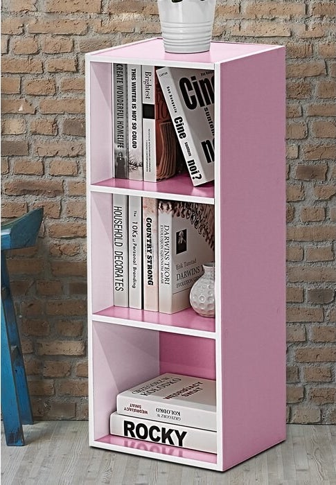 Close up of the White/Pink Cresta Cube Bookcase storing books