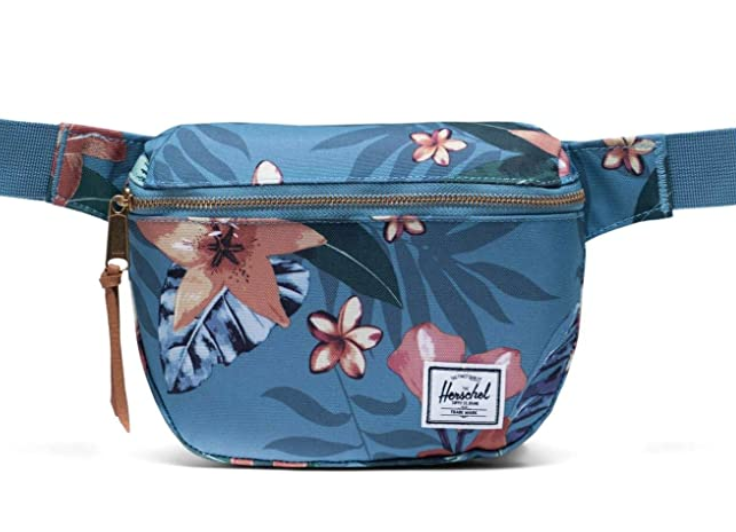 Blue zip fanny pack with pink flowers on it