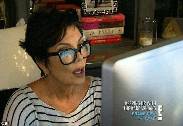 Kris Jenner looking shocked at something on her computer