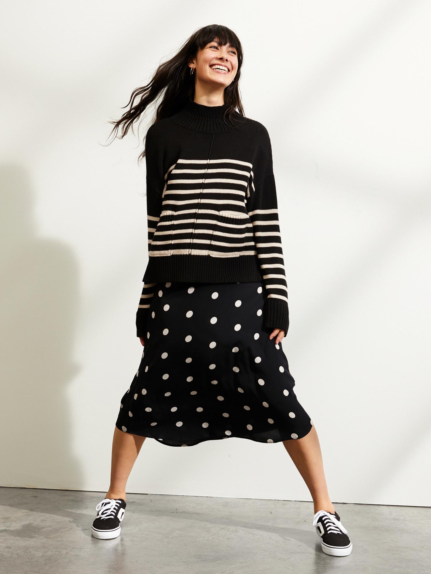 Model wears black and stone stripe mock sweater