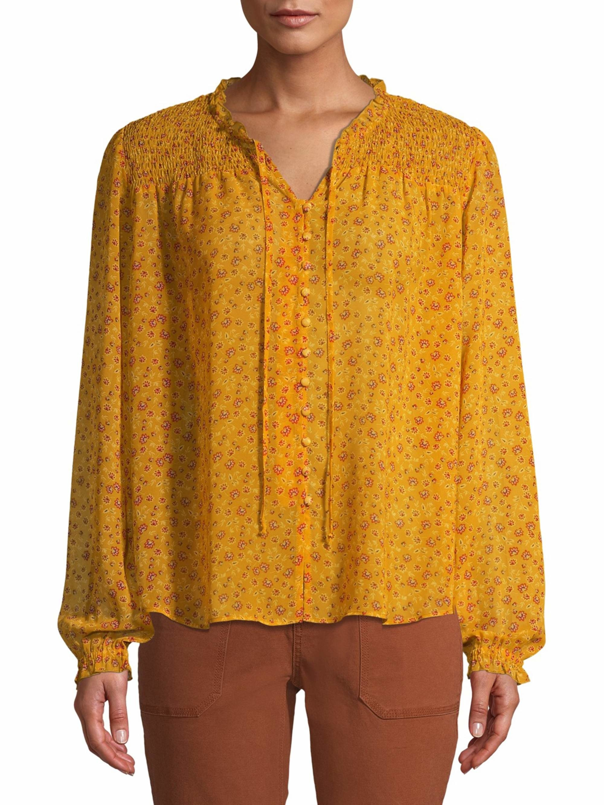 Model wears peasant top in yellow dust floral