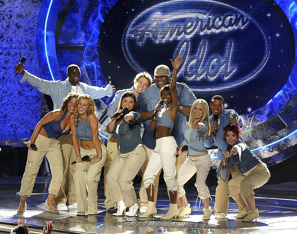 A photo of the Season 2 cast of American Idol performing all together in coordinating khaki pants and denim tops