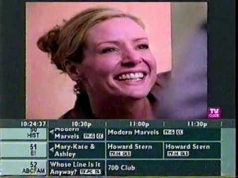 A screenshot of the TV Guide channel of a smiling face from a commercial with some channels scrolling by underneath it