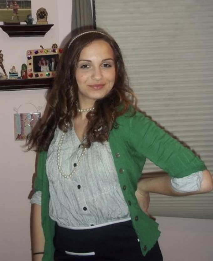 Me in a cardigan, button up top, skirt, pearl necklace, and headband