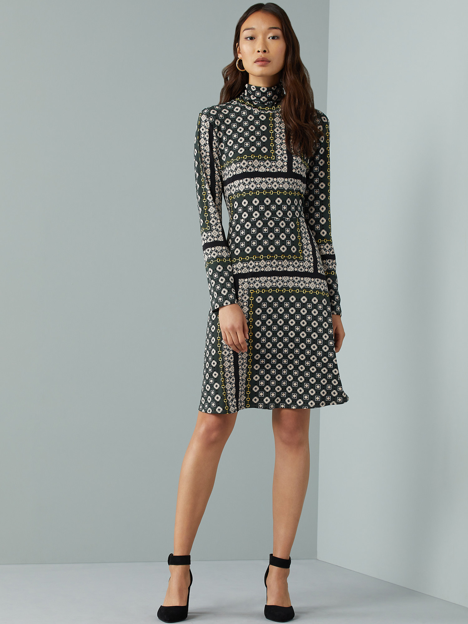 Model wears turtleneck long sleeve dress