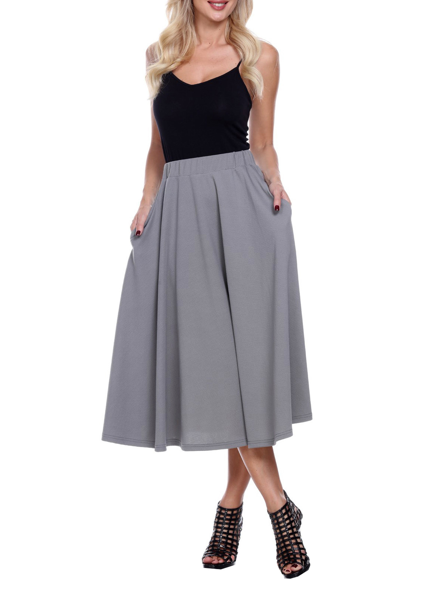 Model wears flared midi skirt in gray