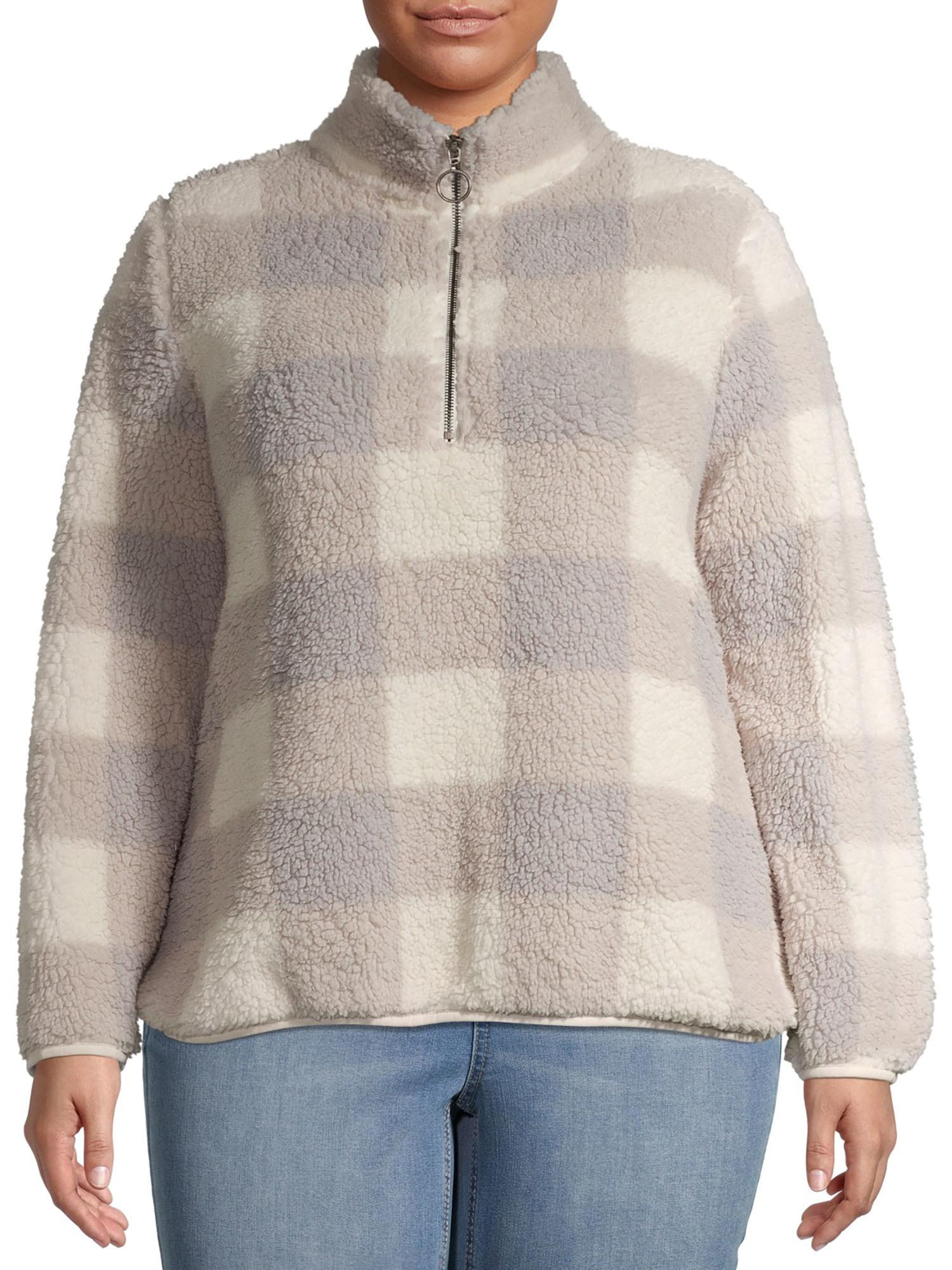 Model wears sherpa quarter zip in marshmallow check