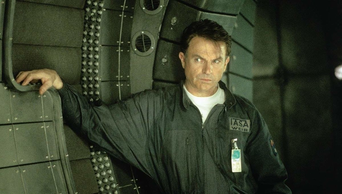 """Sam Neill's character in """"Event Horizon"""" leaning against the interior of a spaceship"""