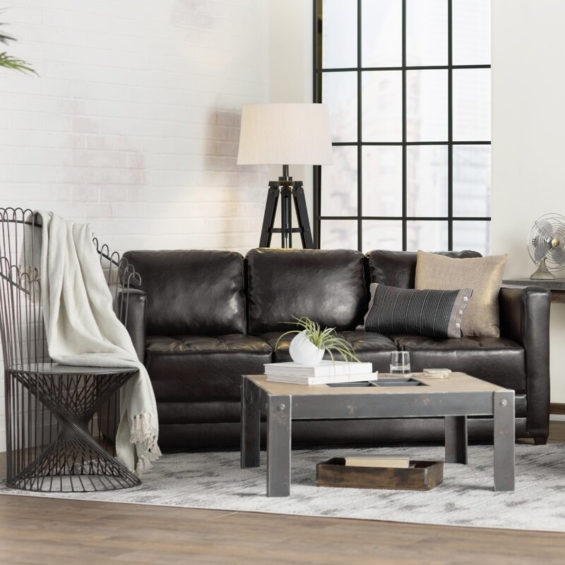 The dark brown faux leather sofa