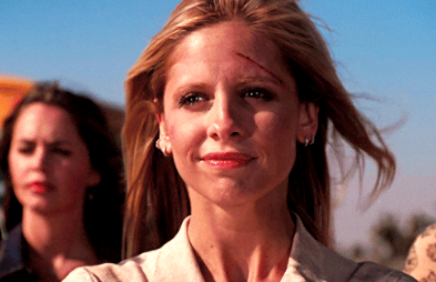 """Buffy standing with everyone near the school bus, the last shot in the series finale of """"Buffy the Vampire Slayer"""""""