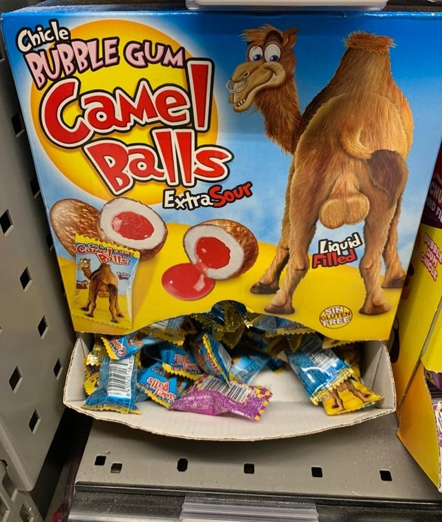 a pack of bubblegum candies that are called extra sour camel balls and a picture of a camel and its pronounced balls grace the outer packaging