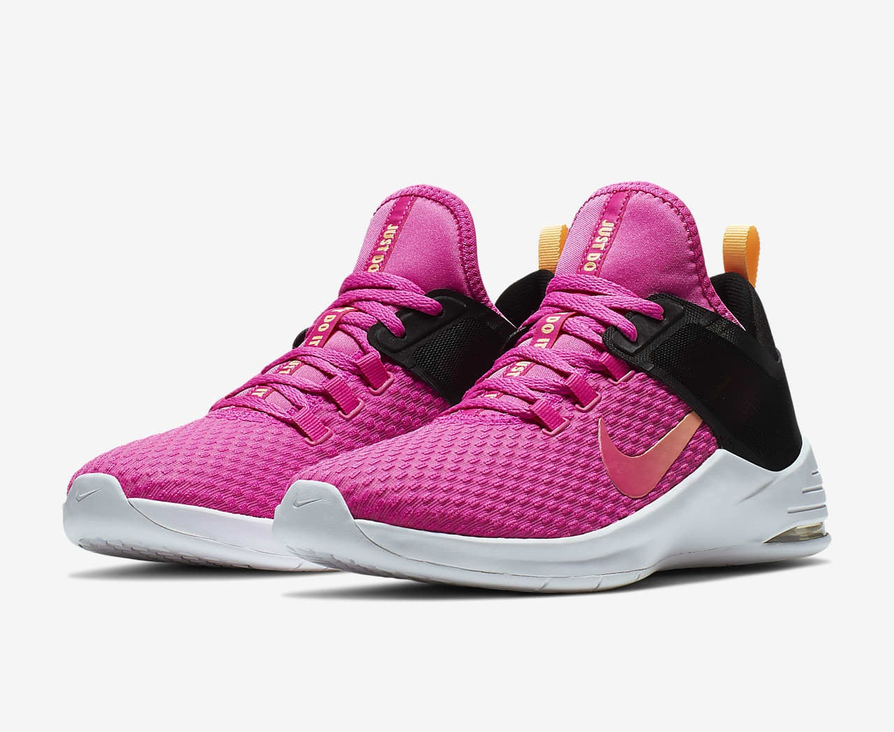 The sneakers in bright pink with white footbed and black heel