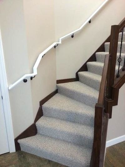 a badly designed staircase with two handrails