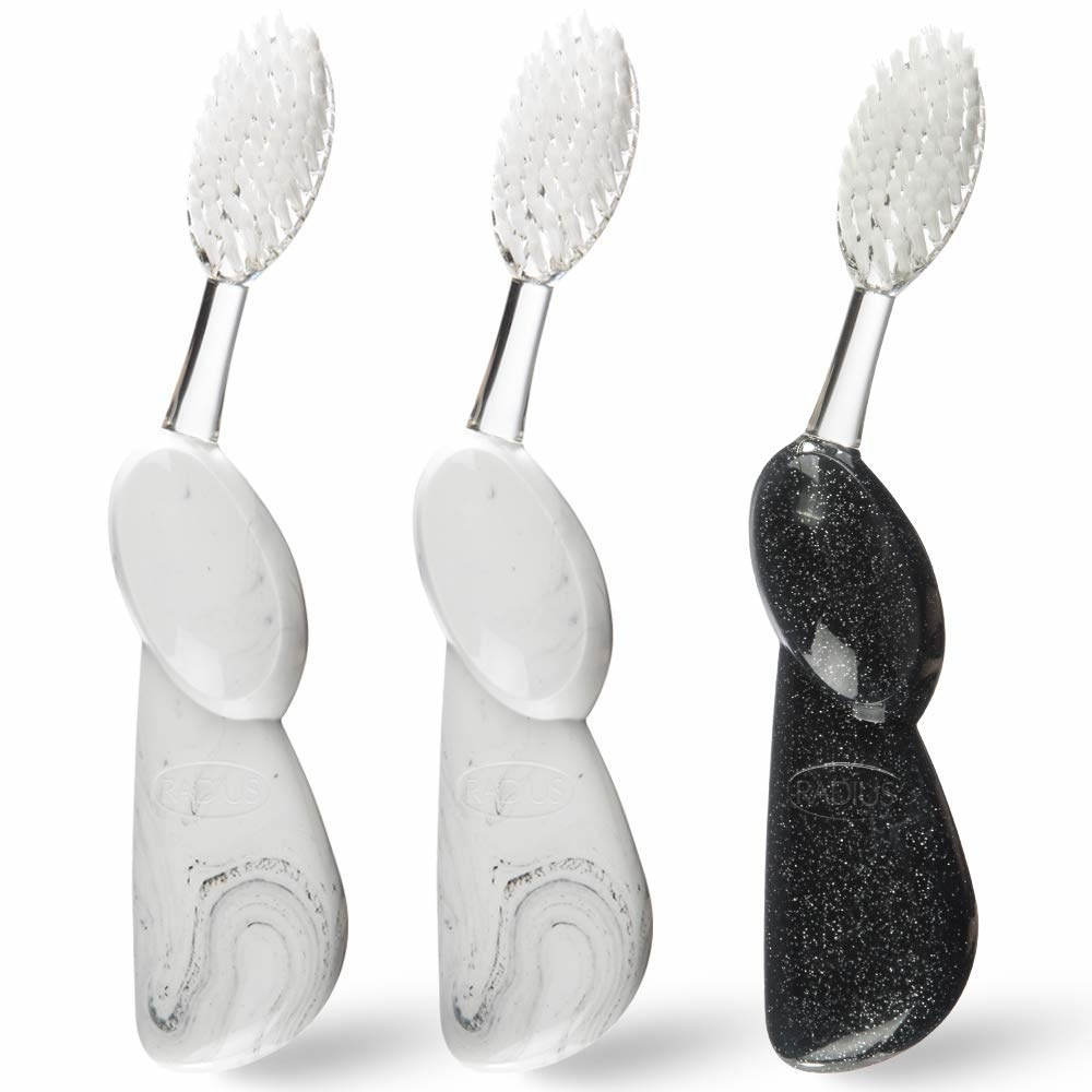 Three large bristled toothbrushes with bulbous handles