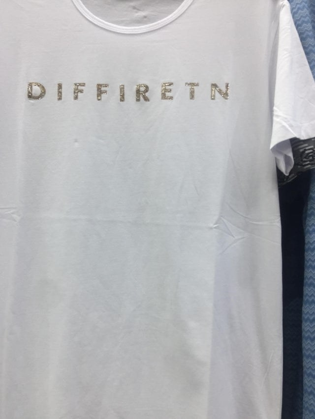 a t shirt that has the word different misspelt