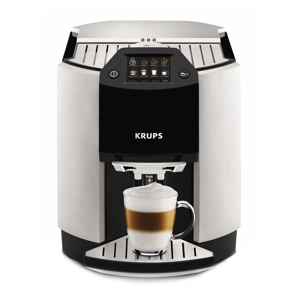 The cappuccino machine with a small cup under the dispenser