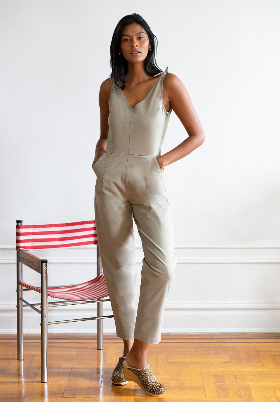 model wearing khaki overalls
