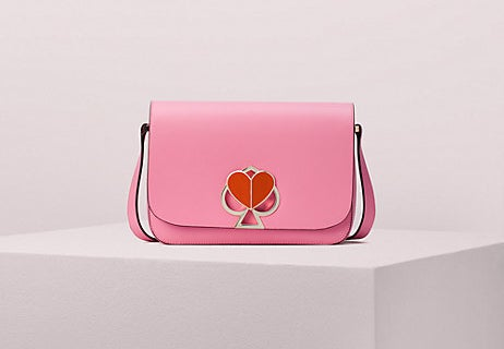 The pink crossbody purse with heart-shaped latch