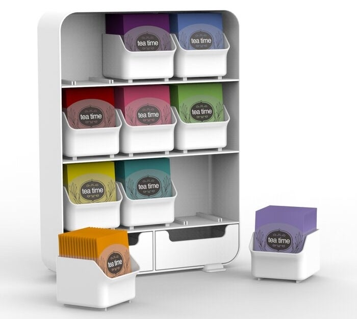 The tea organizer in white holding various flavors of tea bags