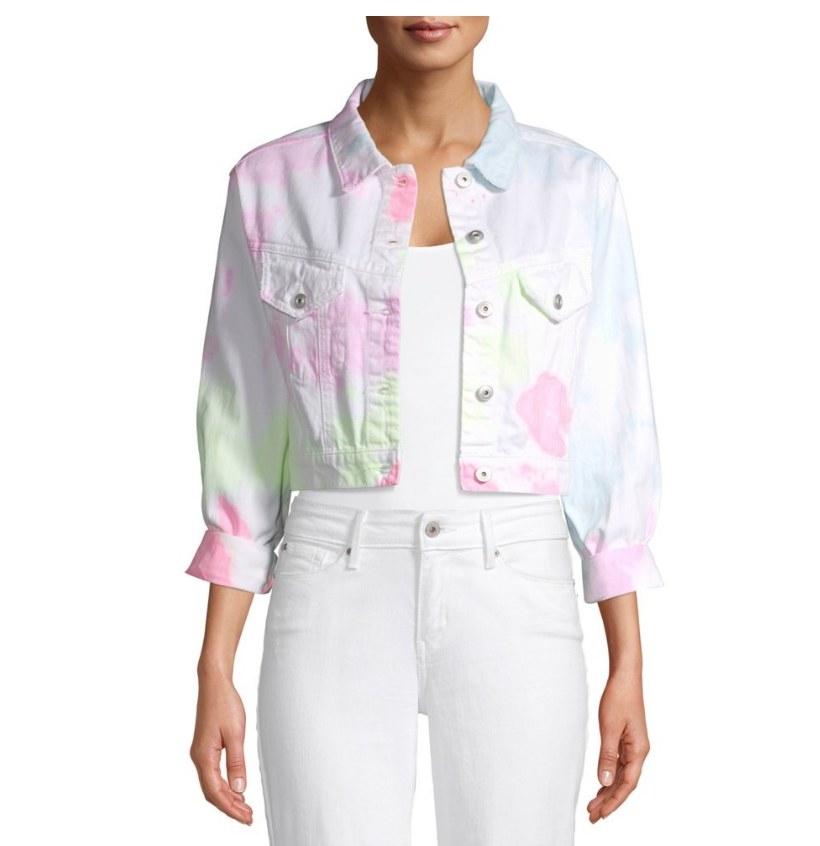 Model wearing pastel tie dye denim jacket