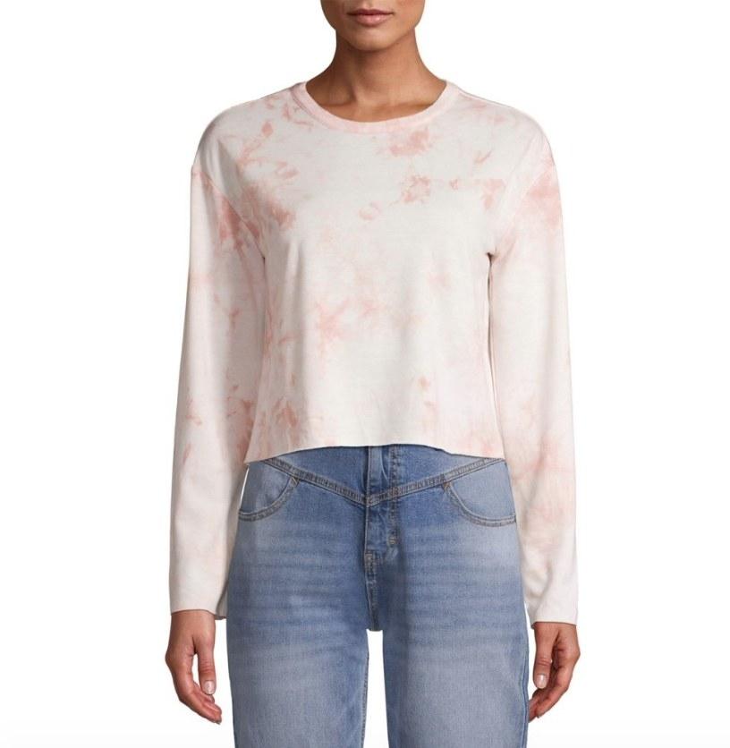Model wearing pink tie dye sweater