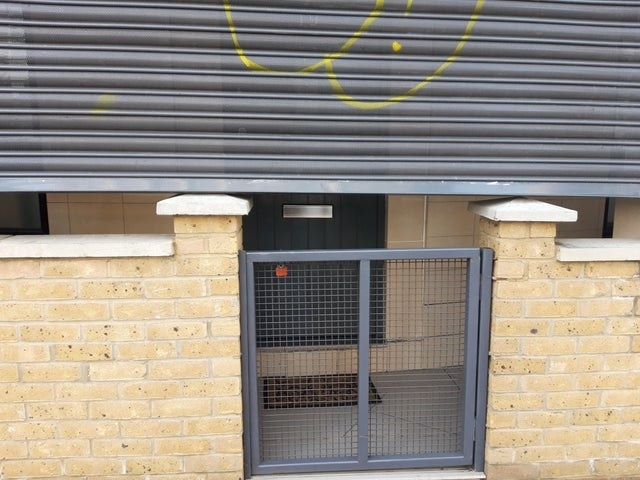 a shutter can't reach the ground because it is blocked by the raised entrance of the establishment