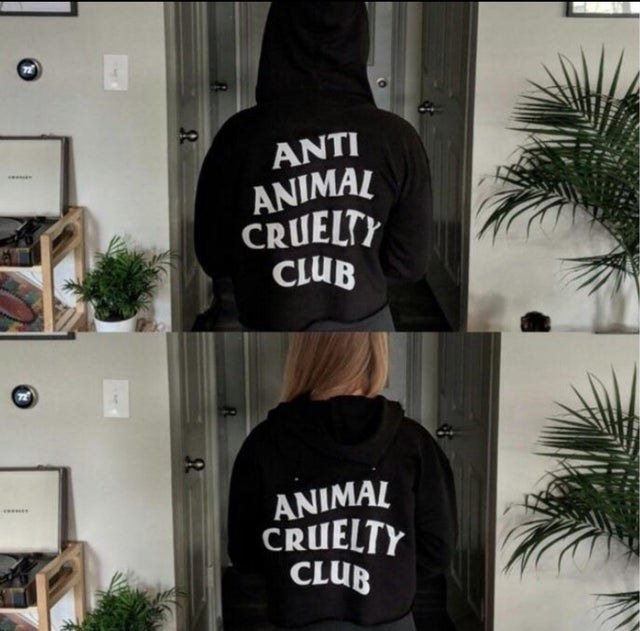 a sweatshirt that says 'anti animal cruelty club' at the back, but when you put the hoodie down, it says 'animal cruelty club'