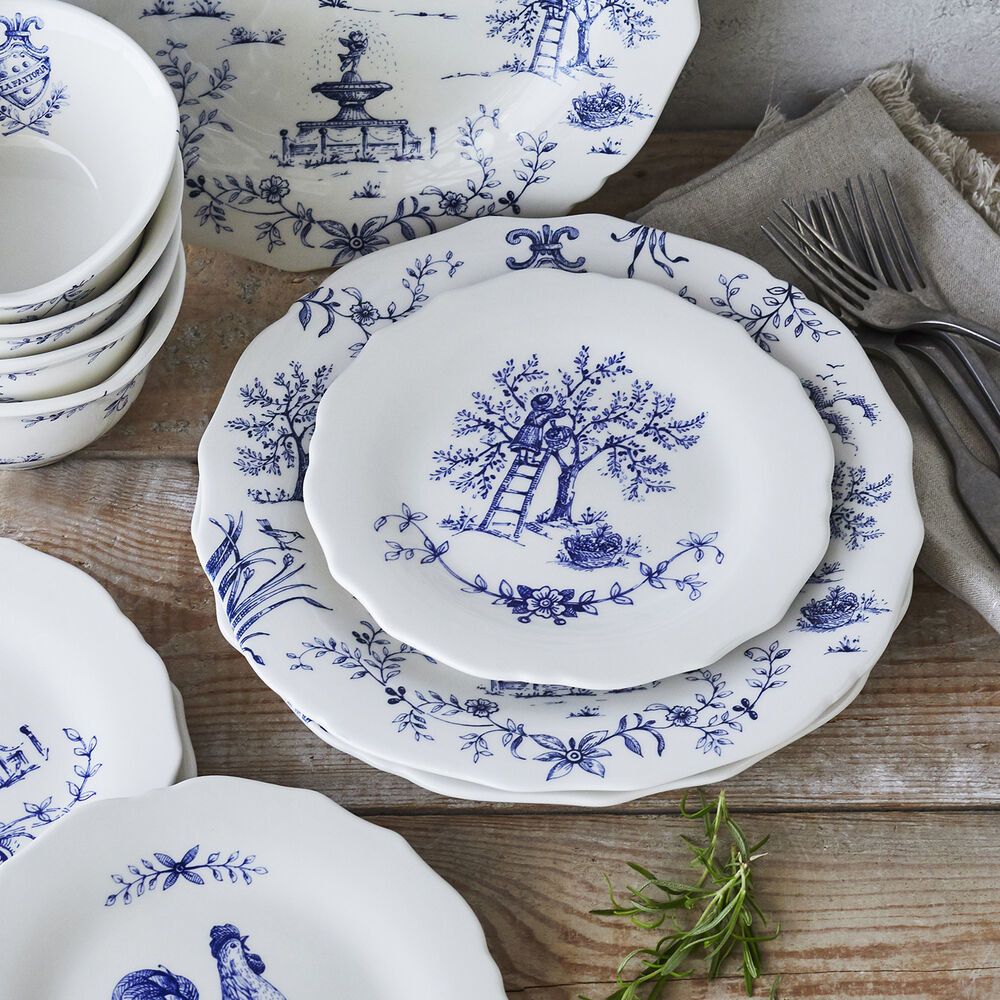 The white plates with blue illustrations