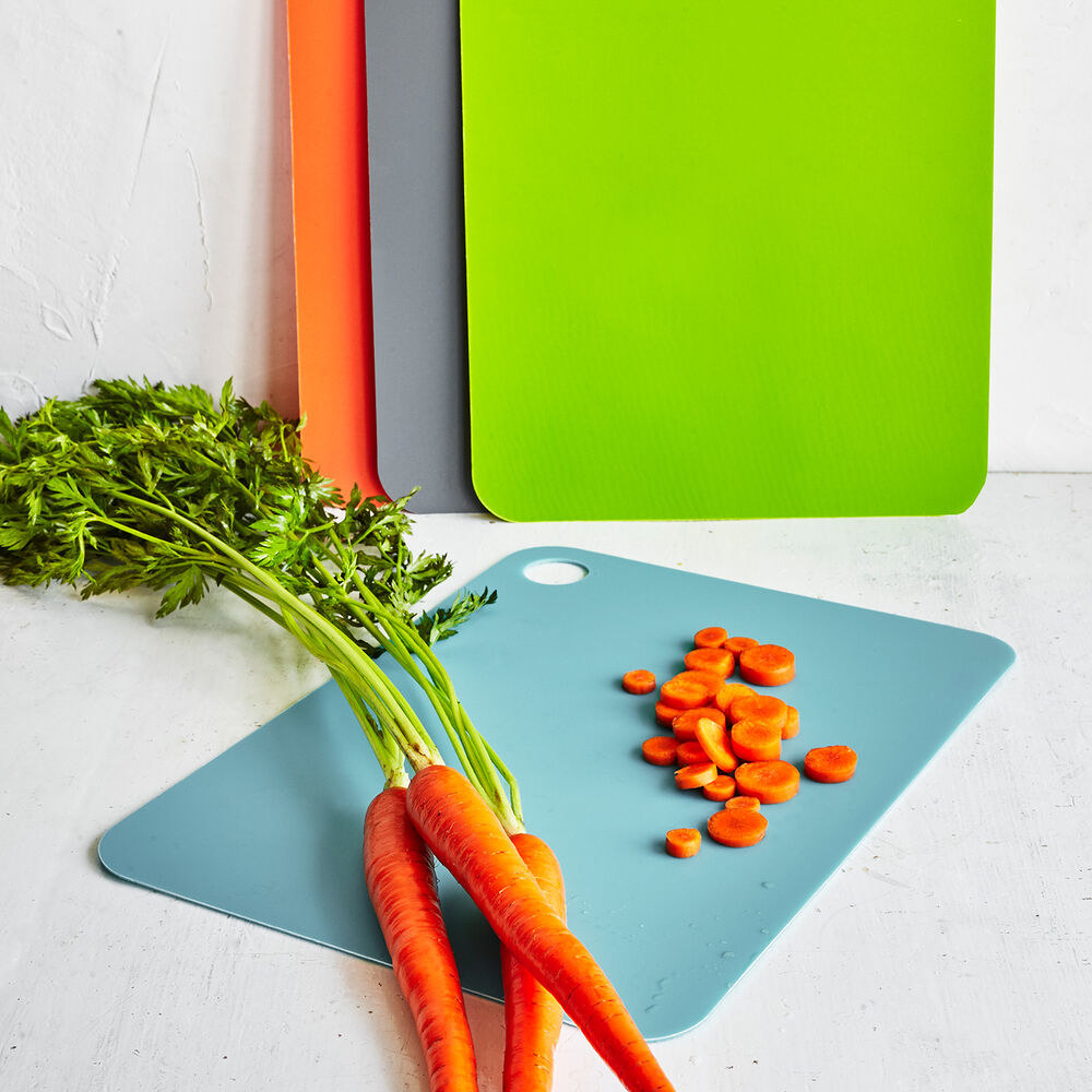 The small cutting boards in blue, green, orange, and gray