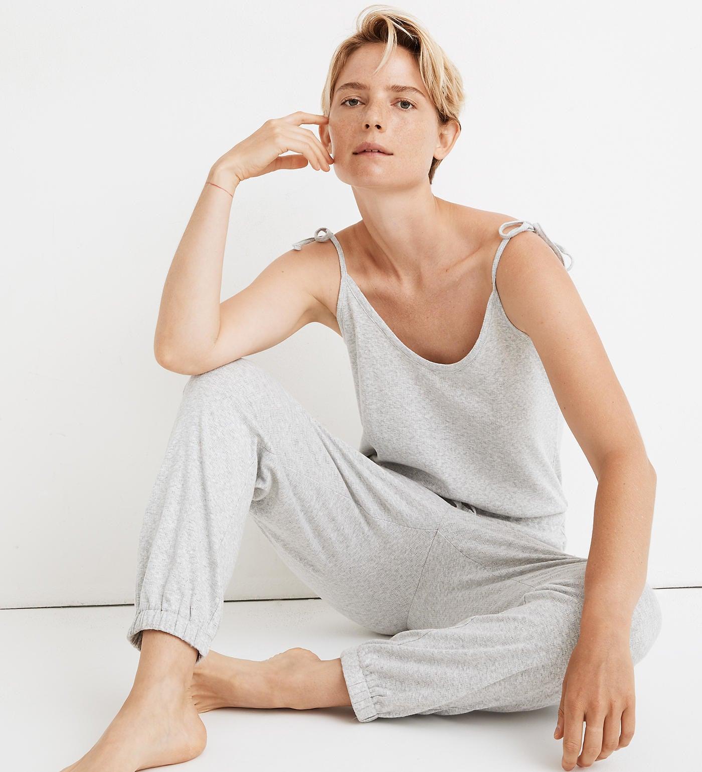 model wearing gray tank top jumpsuit