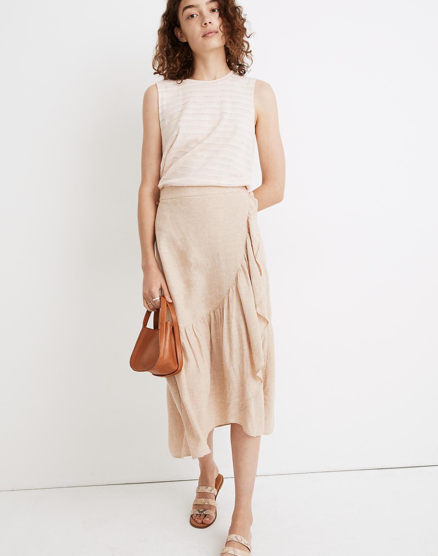 model wear sand colored wrap skirt