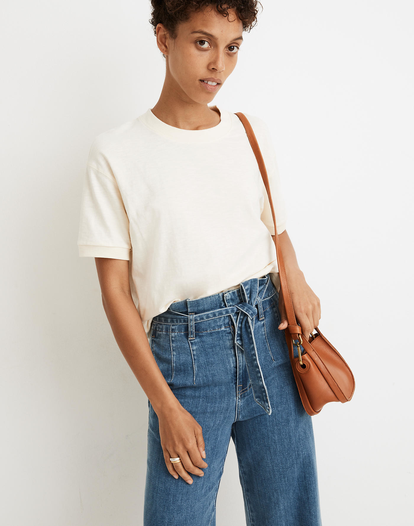 model wearing cropped crewneck off-white tee tucked into jeans
