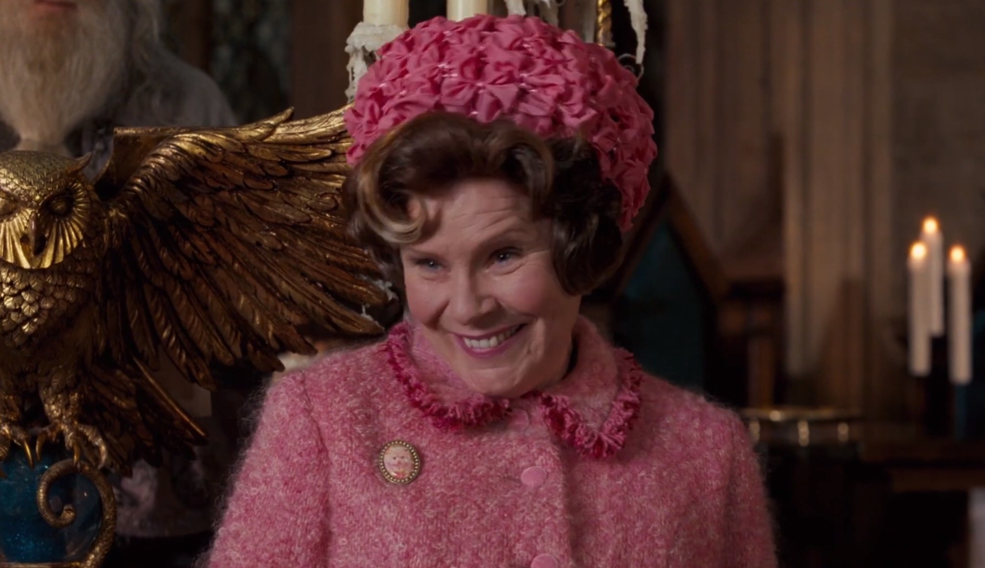 Umbridge with a toad-like smile on that's most definitely evil