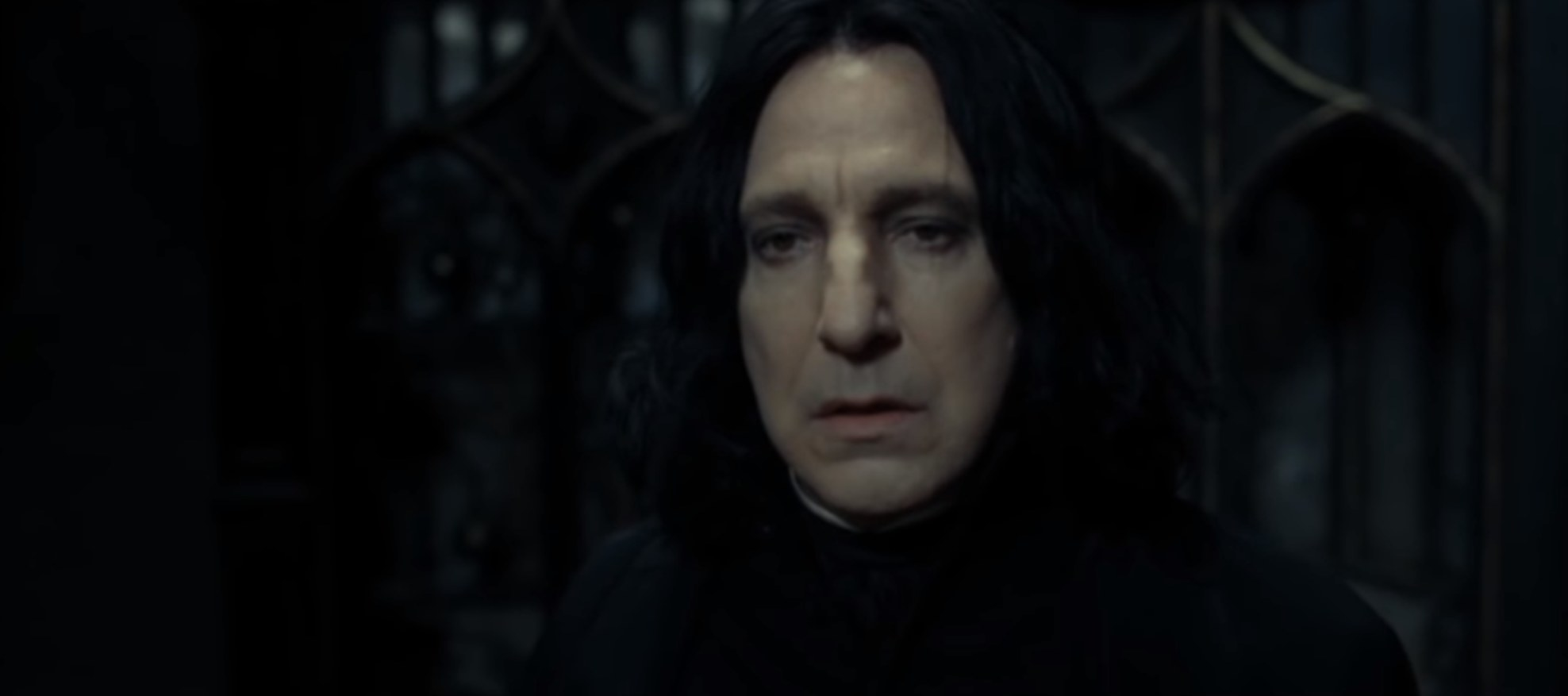 Snape looking forlornly as he remembers the death of Lily Potter