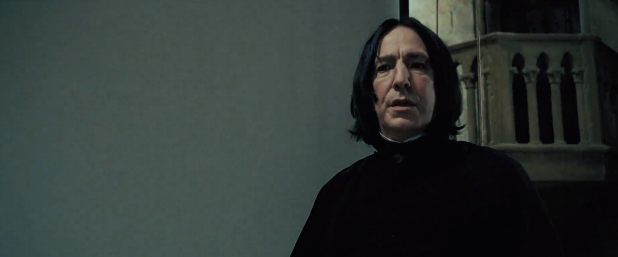 Snape looking down at Harry Potter telling him to turn to a certain page