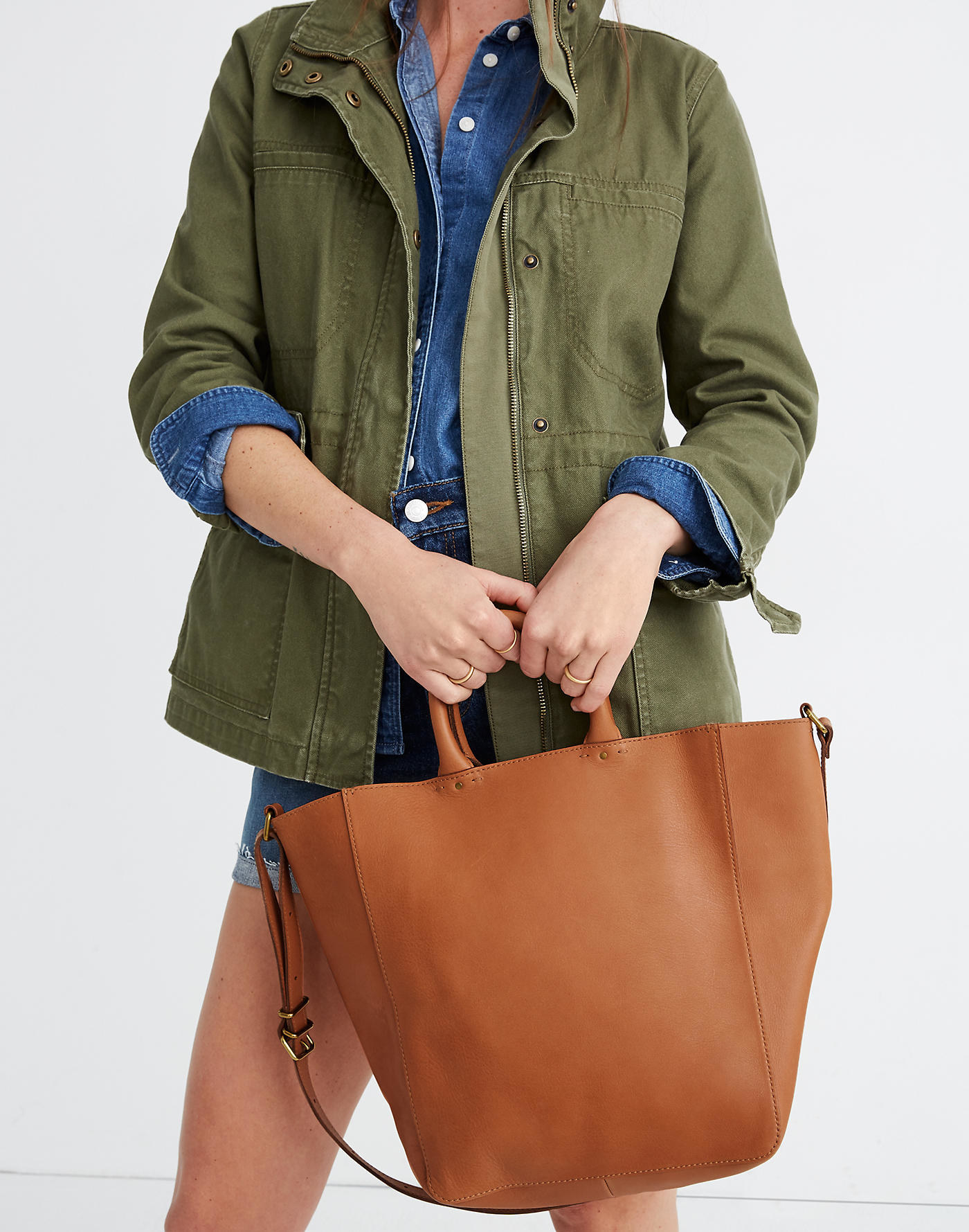 model wearing large camel colored tote bag